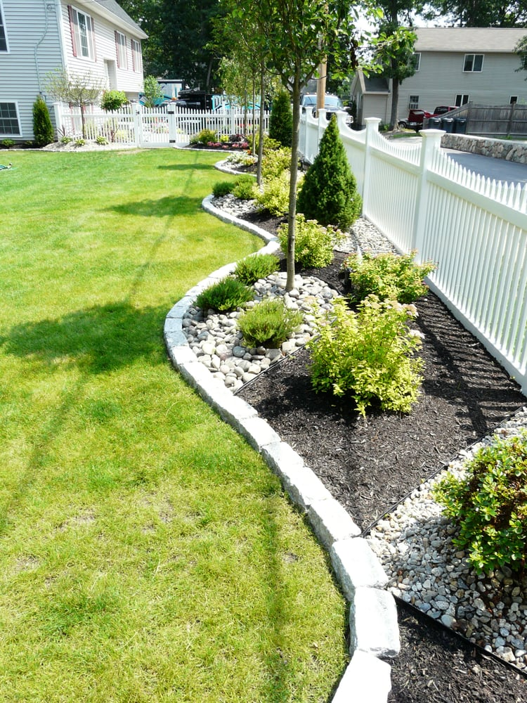 New Vinyl Fence Installation Created A Raised Bed With