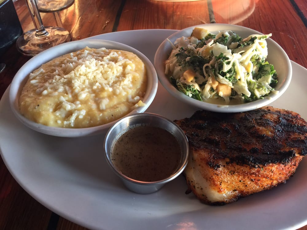 Blackened sea bass with mango kale salad and cheddar grits for Winter park fish company
