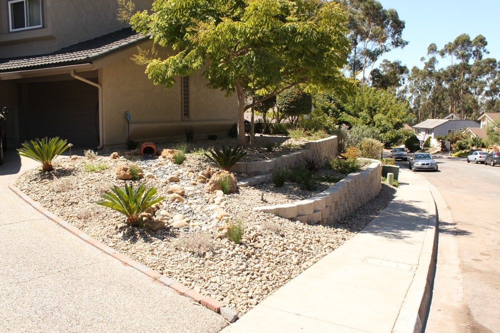 Remodeled Front Yard With Retaining Walls Creek Bed Plants And Low Voltage
