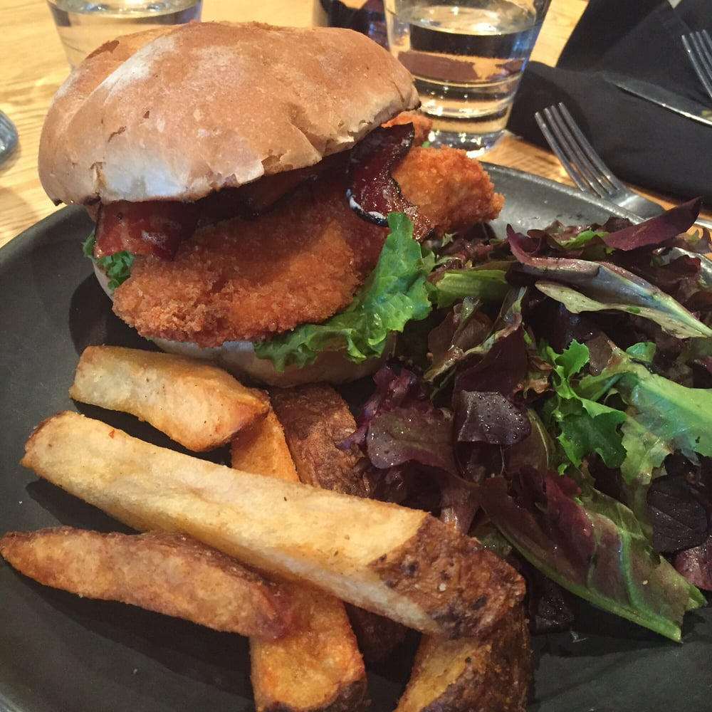 ... Crispy chicken sandwich with bacon slices, piri piri dusted fries and