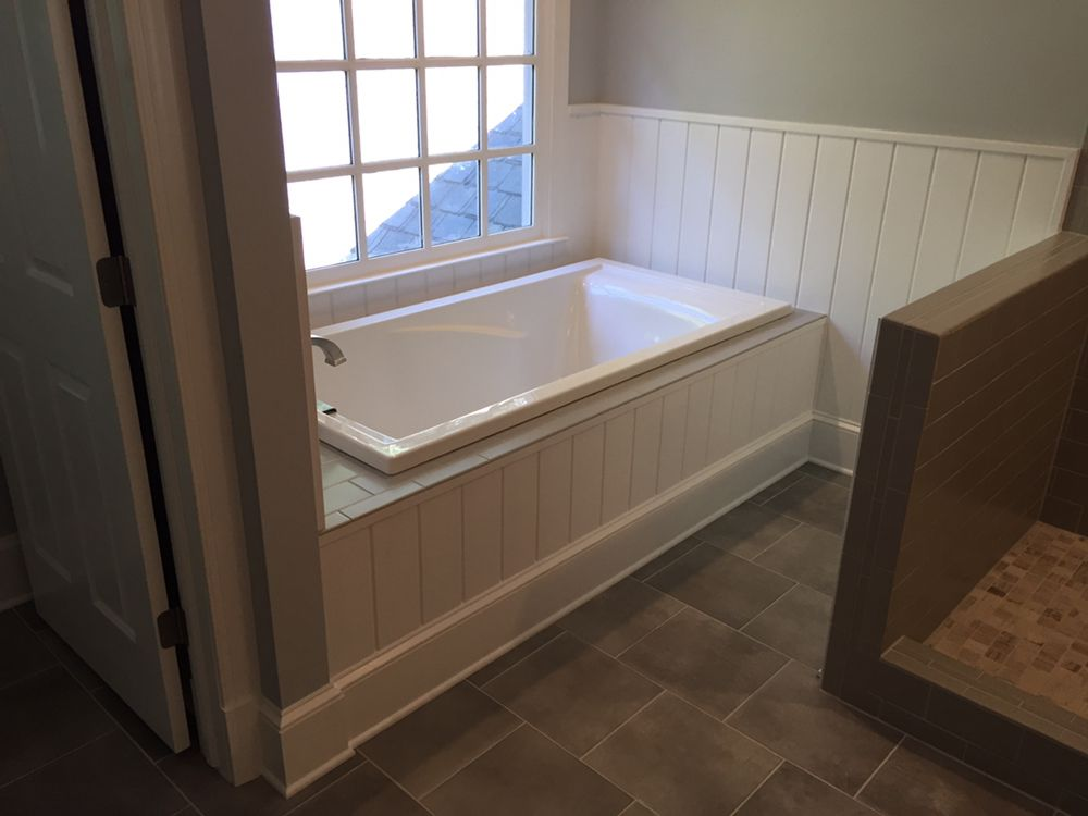 Custom tub surround with tile deck and cypress V-joint wainscoting ...