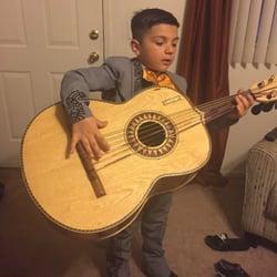 Photo of Botas Guadalajara - Paramount, CA, United States. Pedrito tocando guitarron, will Botas Guadalajara sponsor me ?