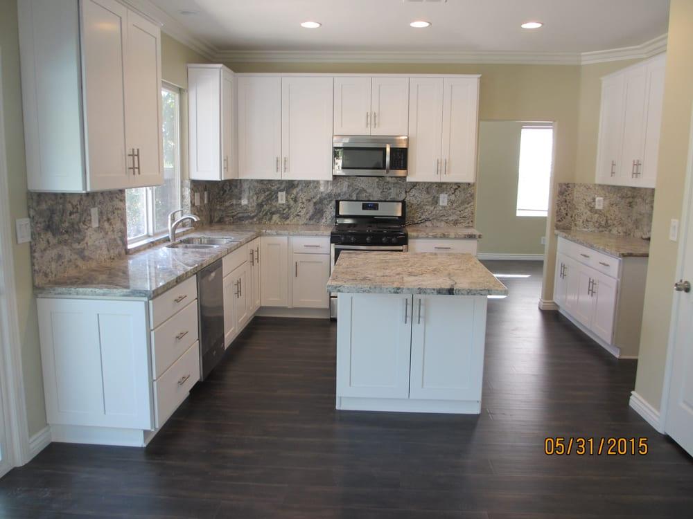 After white shaker cabinets with romanix granite yelp for Romanix granite