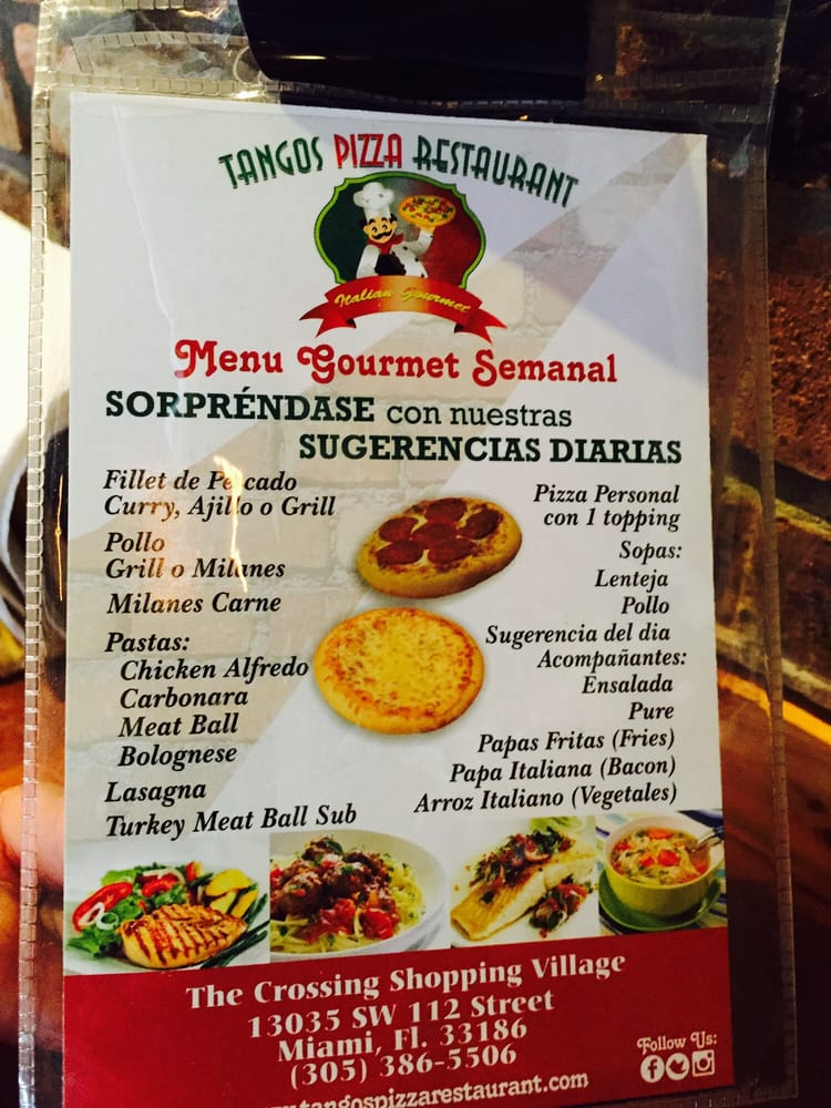 An Italian Restaurant With The Menu In Spanish Both Sides