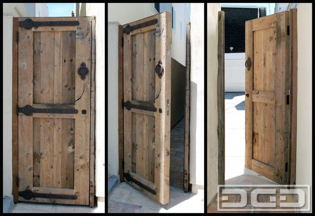Reclaimed wood pedestrian gates in a rustic architectural for Garage door repair near my location