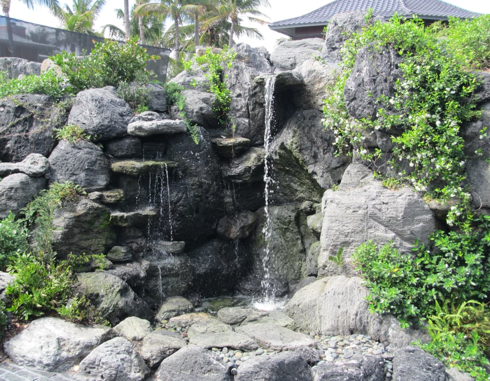 15 39 high volcanic rock waterfall and cave in manalapan for Landscaping rocks fort lauderdale