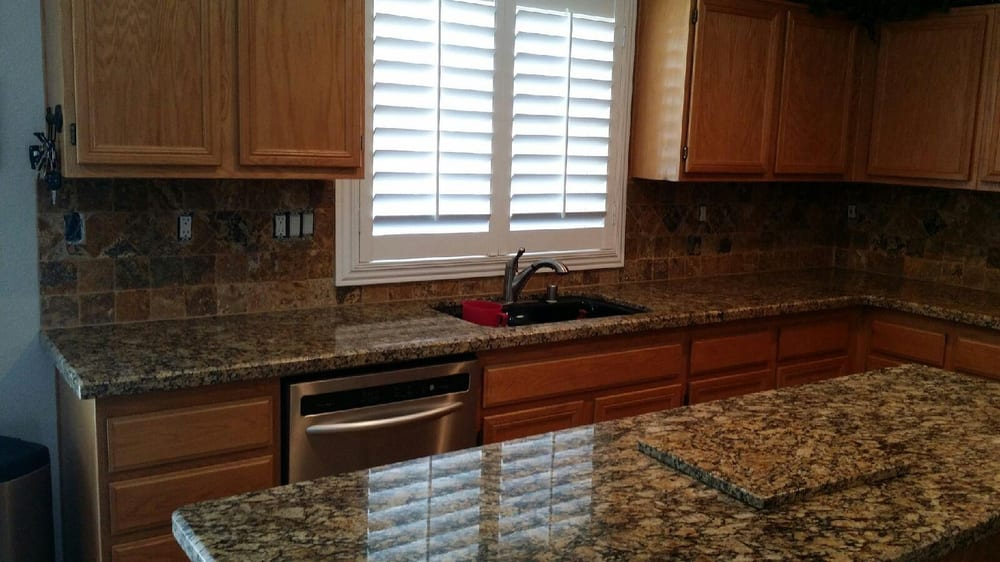 portofino granite with granite cutting board backsplash
