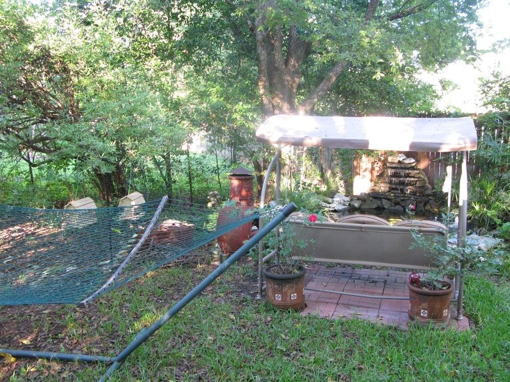 Pleasant Swing Seat Hammock Chimenea And Koi Pond In Semi Private Interior Design Ideas Clesiryabchikinfo