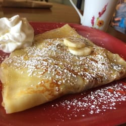 ... peanut butter and banana crepe topped with honey and powdered sugar