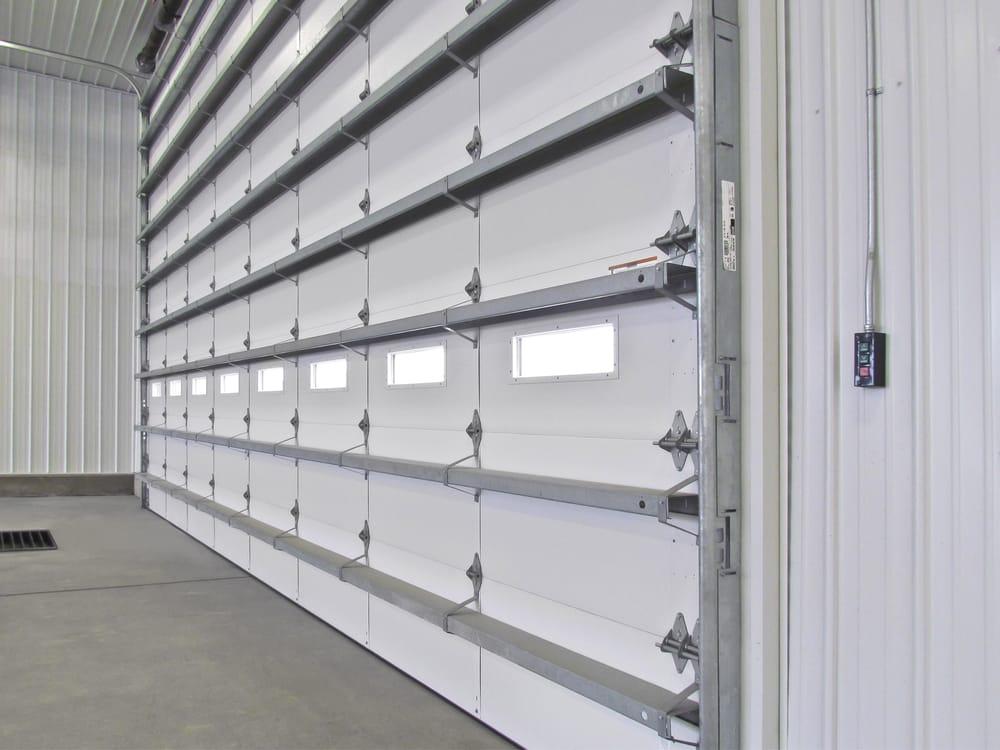 Commercial garage door wind cod with windows yelp for Wind code garage doors