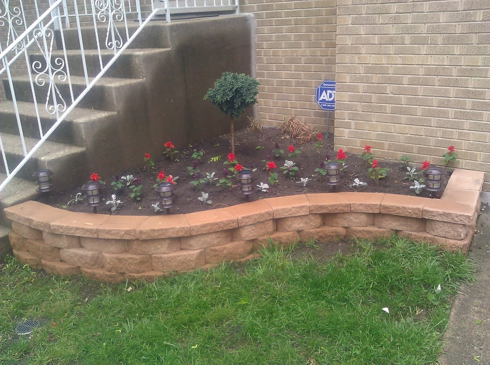 Raised flower bed yelp for Brick flower garden designs