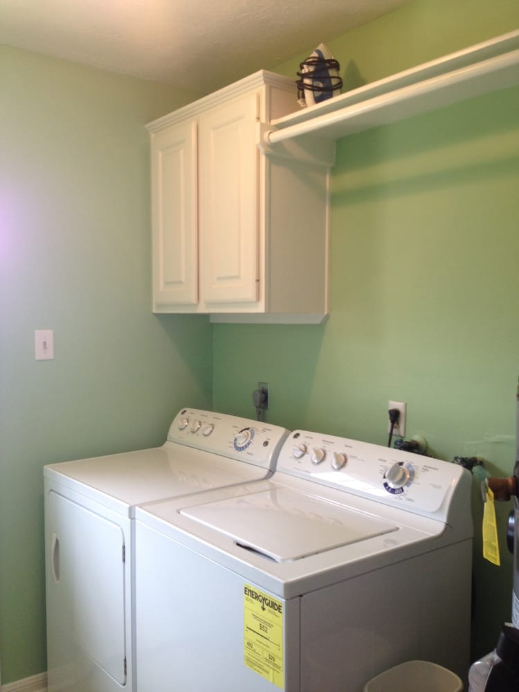 installation of cabinets and cloth hanging rod in laundry room Yelp