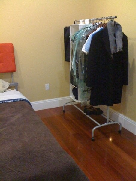 Rigga Clothes Rack with white closet storage and another bag with a zipper that one can place