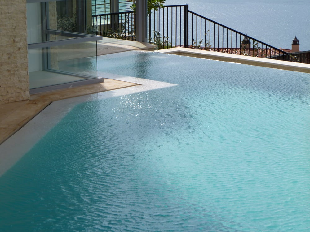 Infinity Edge Pool With Spa Slot Overflow On House Side
