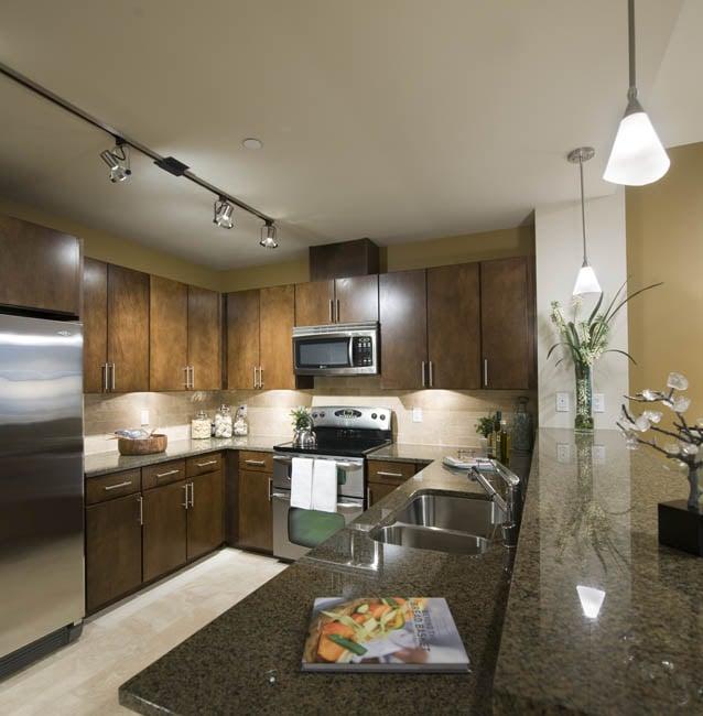 Open Concept Gourmet Kitchen With Granite Slab Countertops