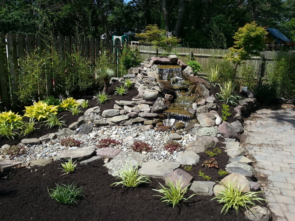 Pondless waterfall landscape design and bamboo install yelp for Earth designs landscaping