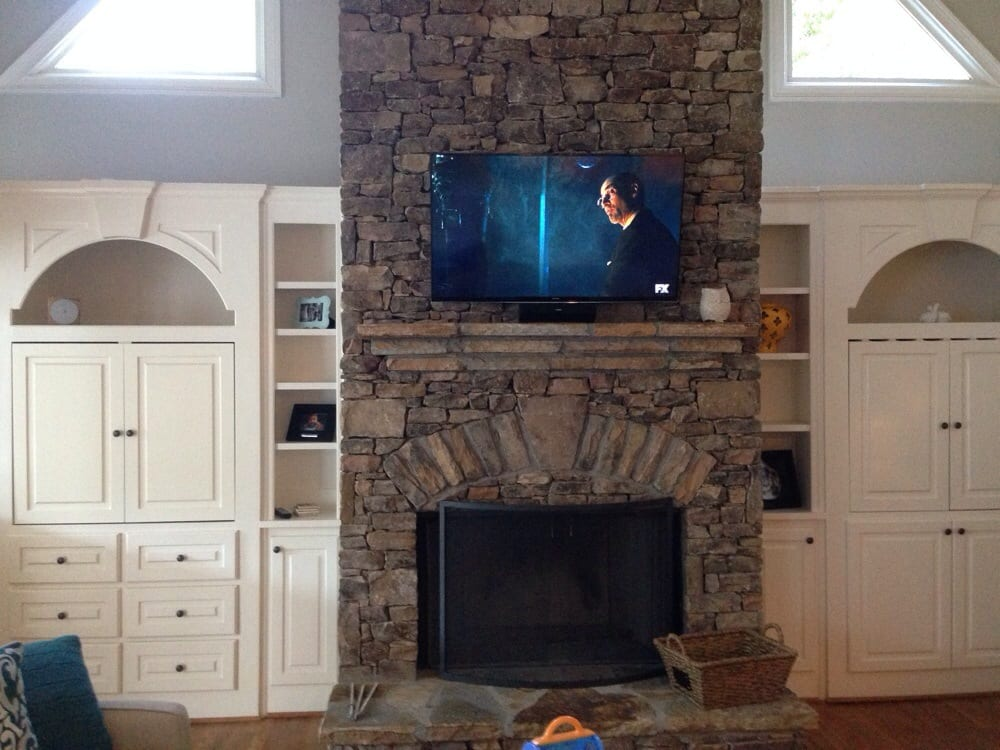 TV mounted on stacked stone fireplace Yelp