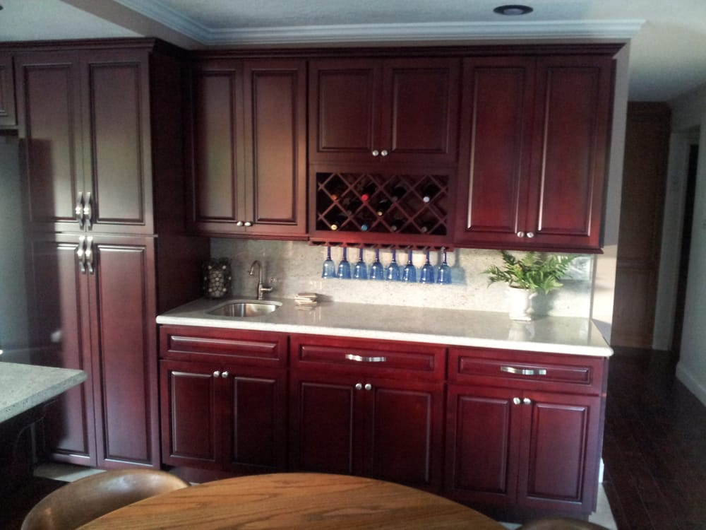 Choice granite kitchen cabinets inside showroom yelp why for Cherry and white kitchen cabinets