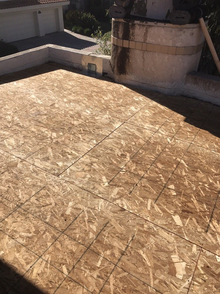Changing The Slope Of A Flat Roof And Installing New