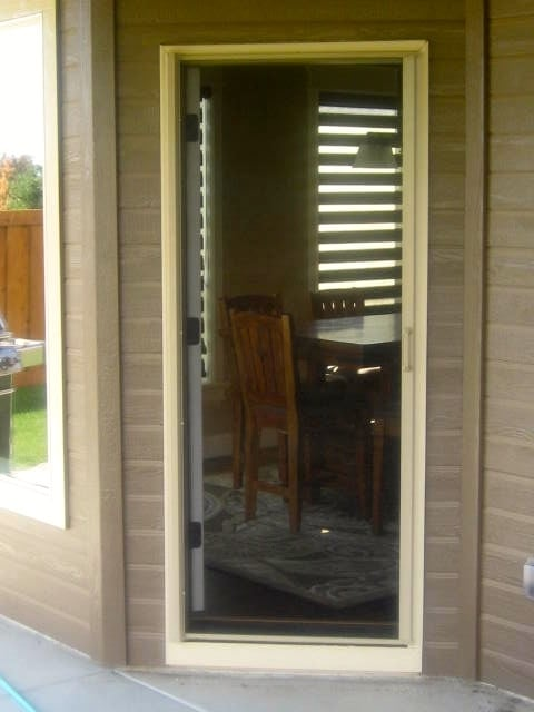 This is a patio in swing patio door with a phantom screen for Phantom screen doors reviews