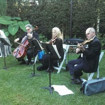 Photo Of Seaside Strings Wedding Ceremony Music
