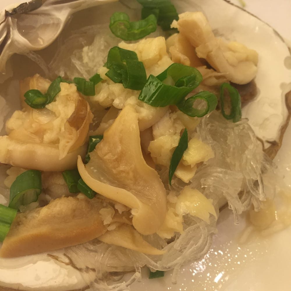 Surf clam steamed with garlic and vermicelli noodles. Noodles were ...