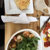'Photo of Brasil - Houston, TX, United States. Shrimp and grits with fried oysters' from the web at 'https://s3-media2.fl.yelpcdn.com/bphoto/PC2dYaNplTauCcJU3BNitw/168s.jpg'