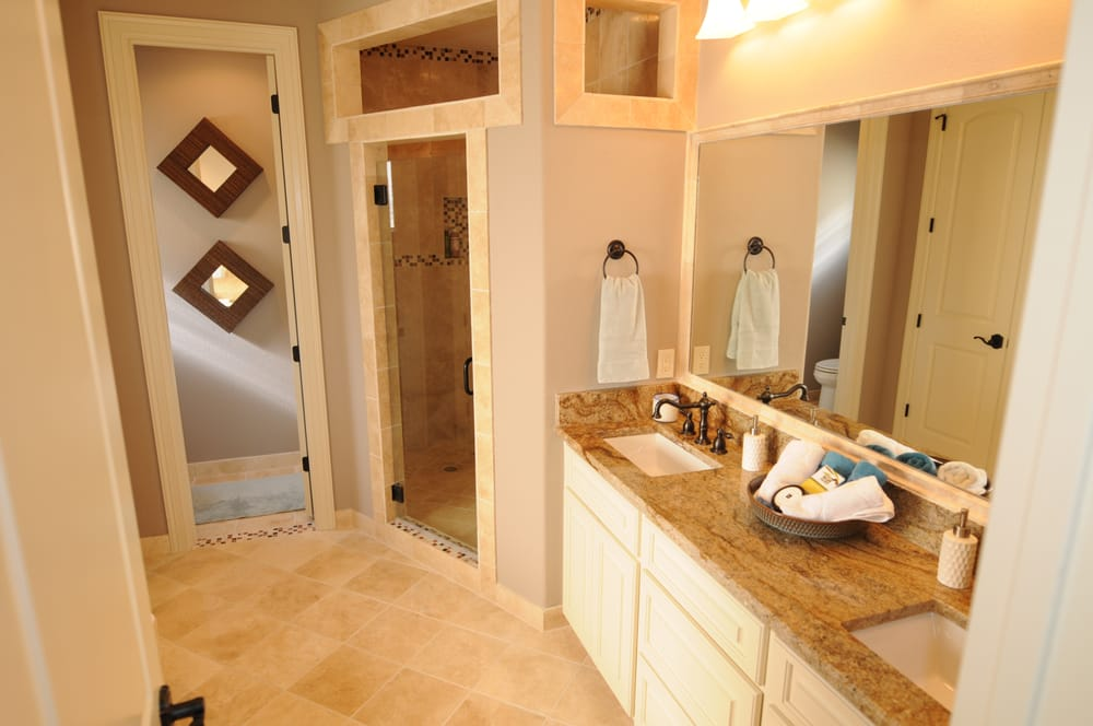 Travertine with marble inlays and granite countertops for Bathroom remodel yelp