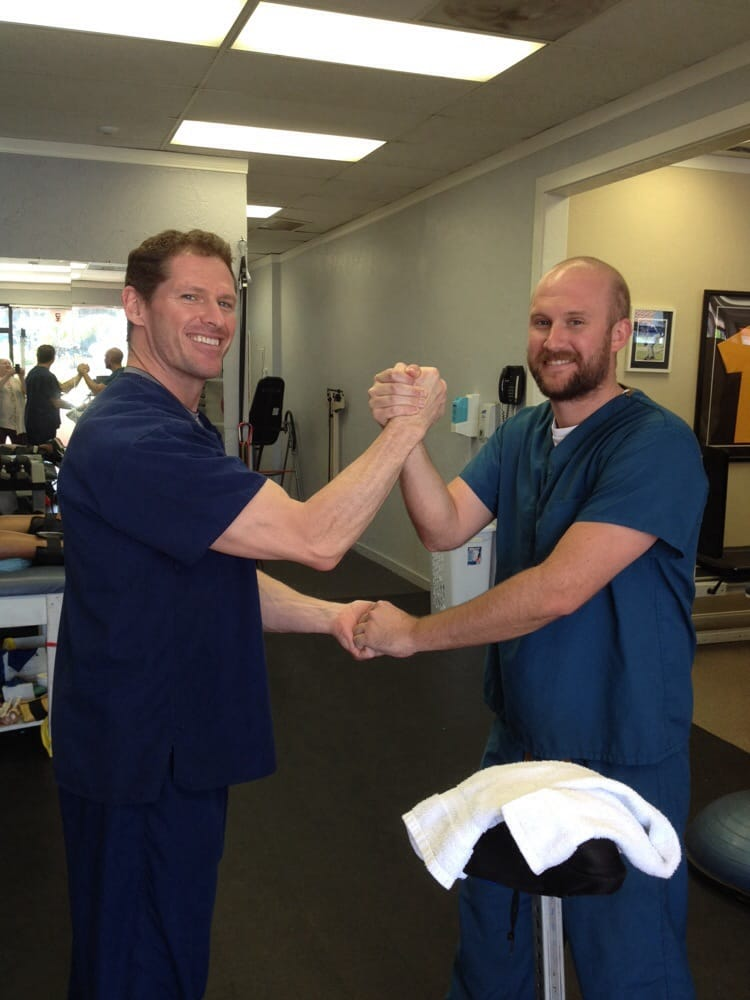 Tim McCauley, MPT, OCS and Justin Hurley, PT aide, get an arm up on ...