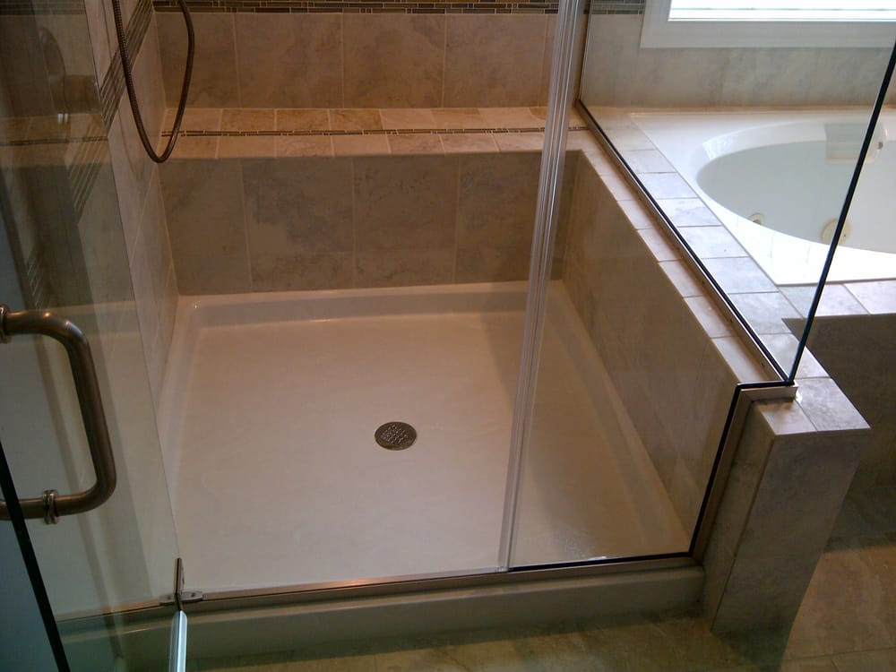 Cultured marble shower pan with bench seat and new porcelain tile ...