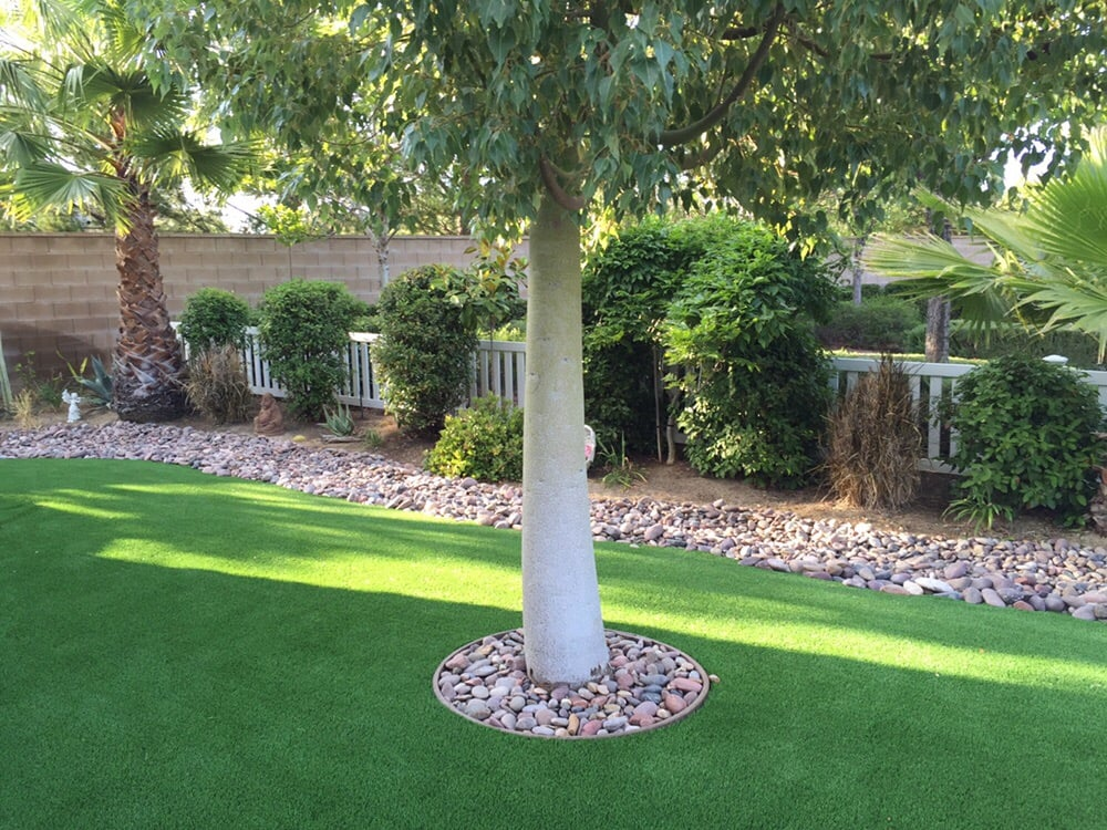 synthetic turf and river rock with bender board ring for. Black Bedroom Furniture Sets. Home Design Ideas