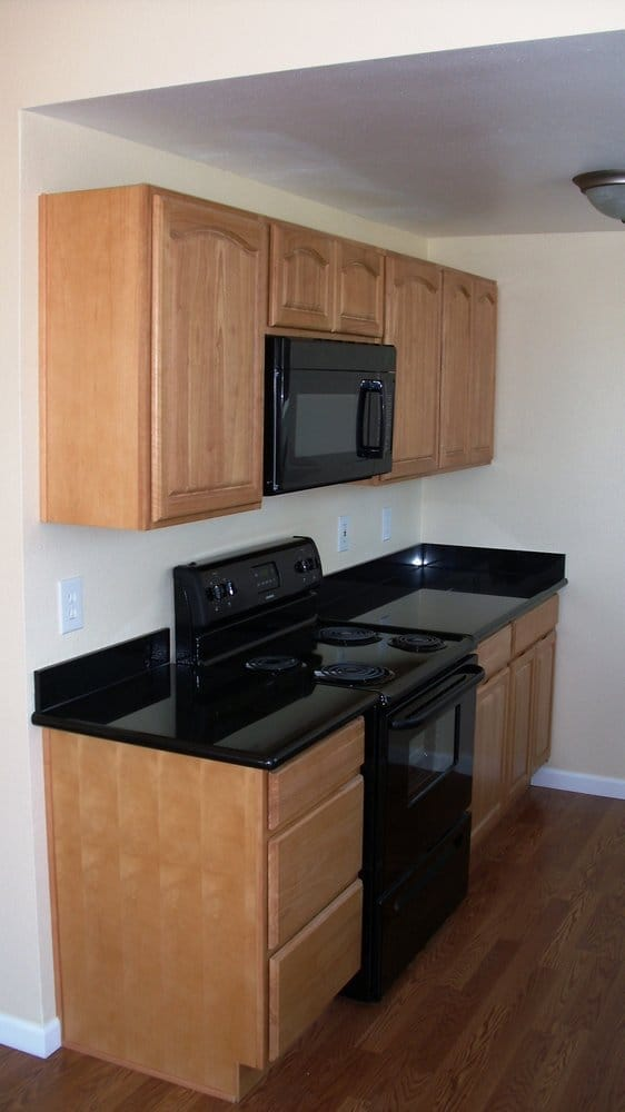Restored Kitchen With Complete Black Appliances Package True Black Granite Counter Tops And Oak