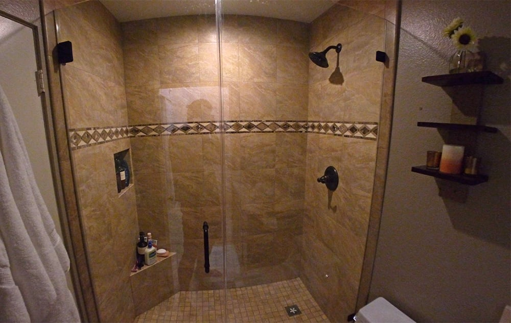 New frameless shower door shower enclosure with sandstone tile ...