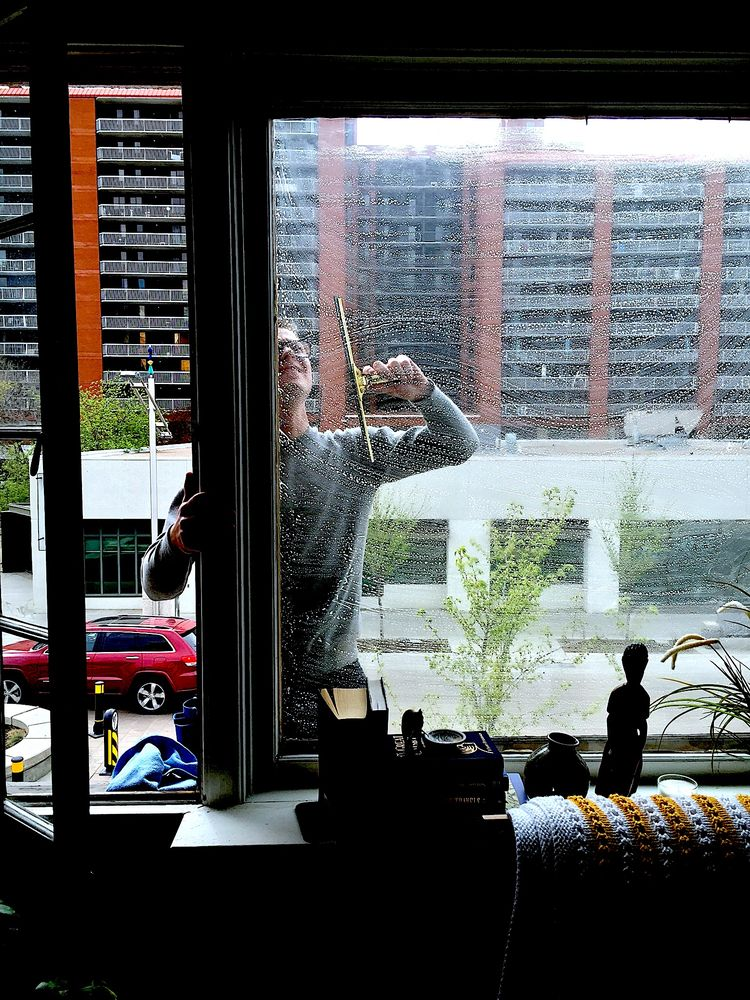 Using a soapy solution to clean those hard to reach windows