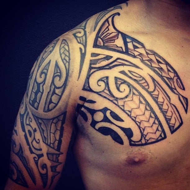 Chest Piece Tattoo Prices: Freehand Poly Tribal Chest Piece. Artist: Tony