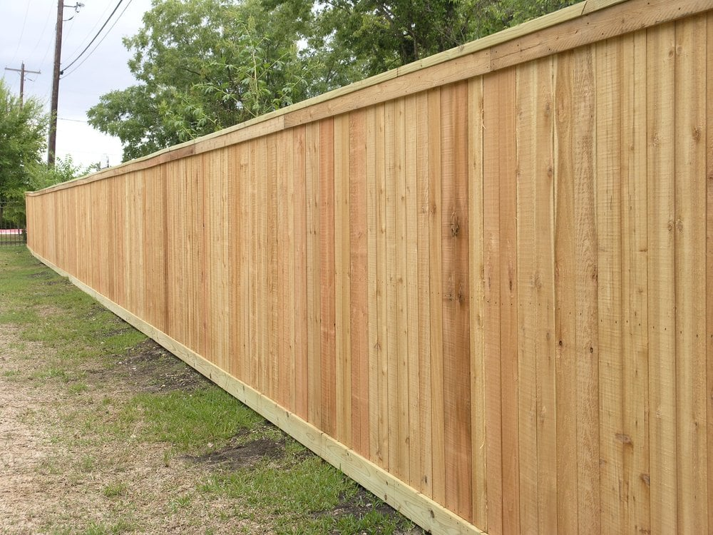 Western red cedar privacy fence with top cap