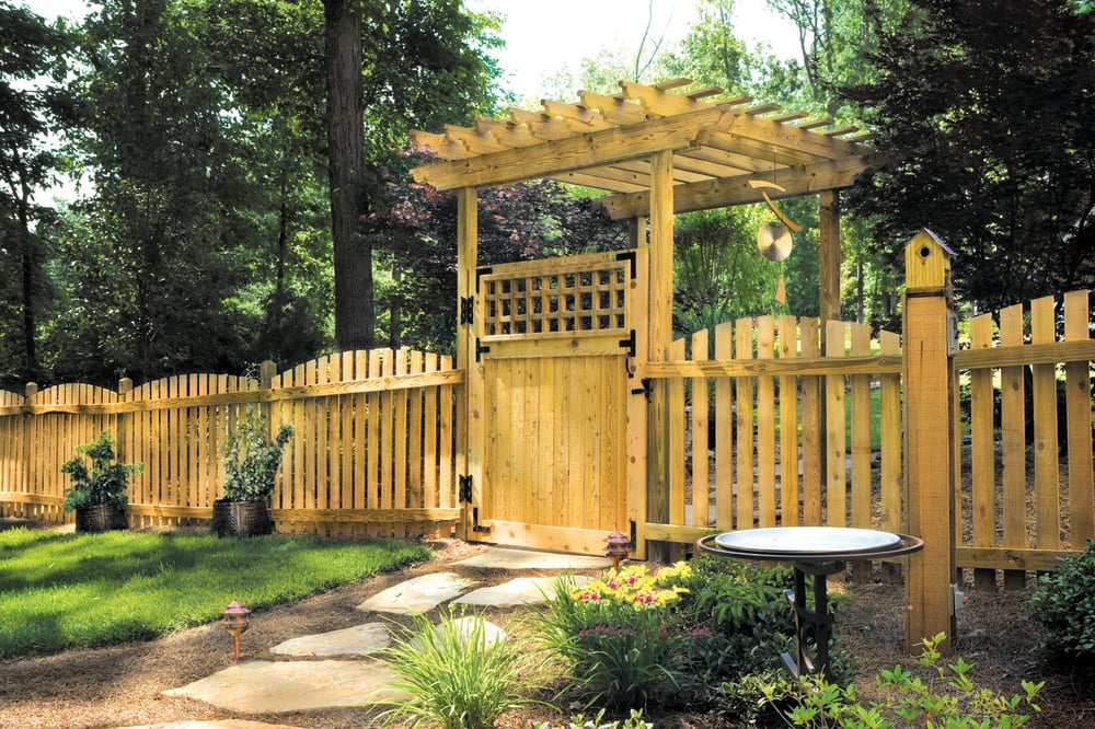 Asian Gate Shaded By Arbor With Adjoining Picket Fence