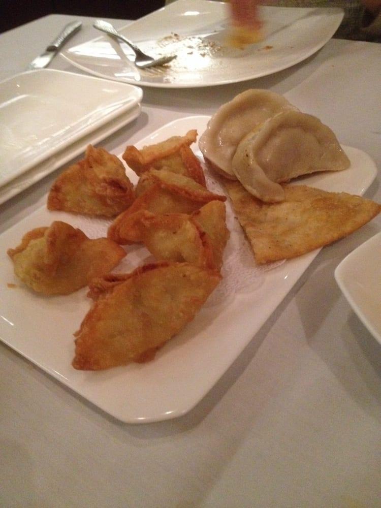 Yummy apps, crab Rangoon, perfect scallion pie, Peking ravioli - Yelp