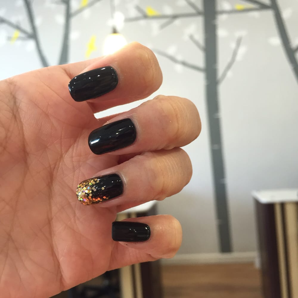Black gel manicure with a gold glitter ombré on one finger - Yelp