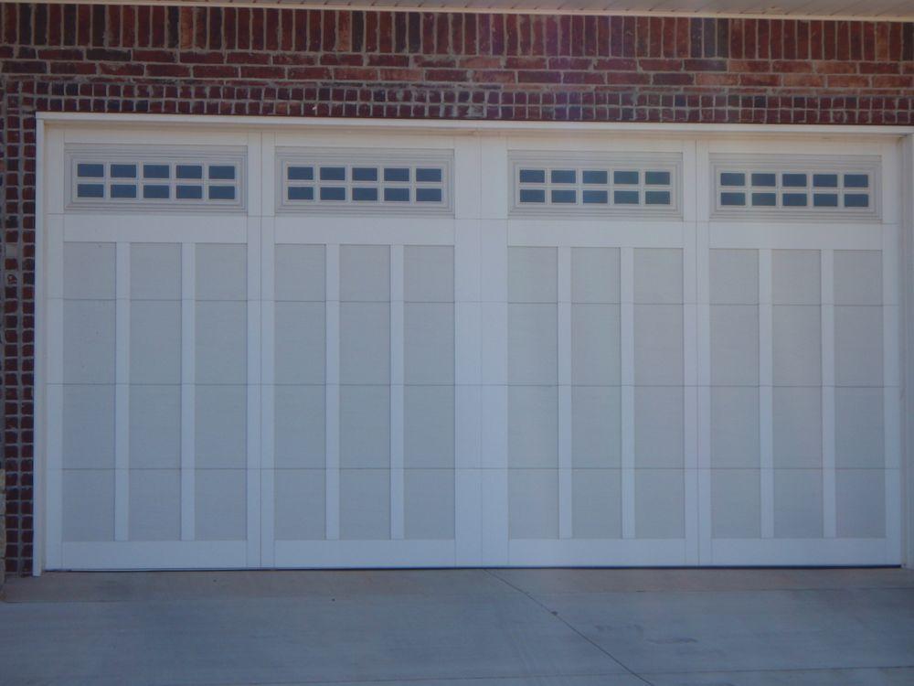 norman property overhead garage kauai door photo normans doors