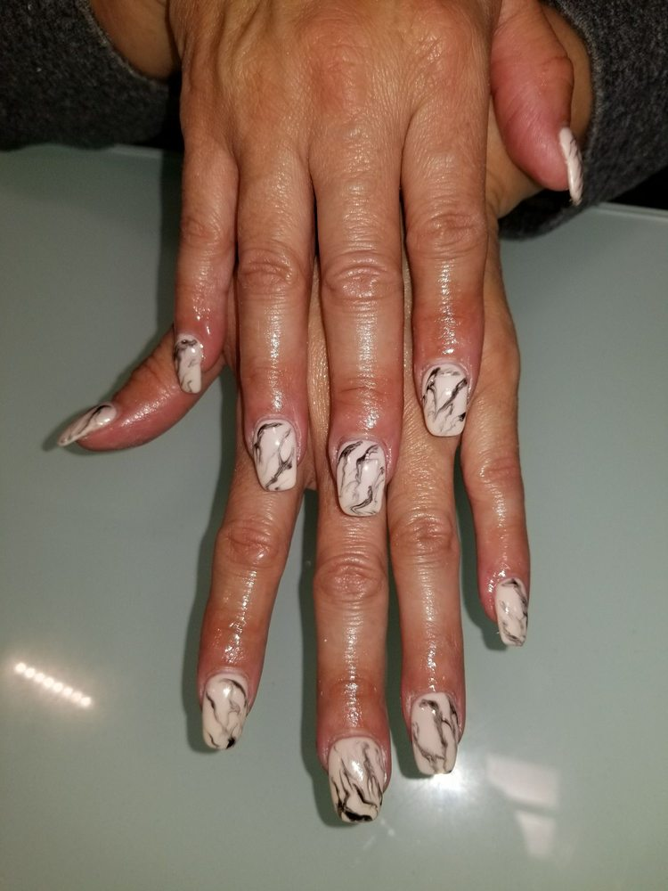 Katie's Nails & Beauty Studio: 3333 S Tamarac Dr, Denver, CO