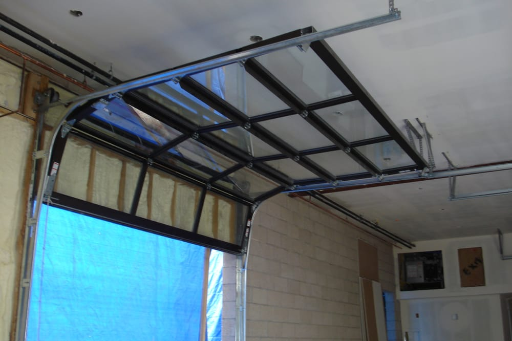 We Had To High Lift These Glass Garage Doors Installed In