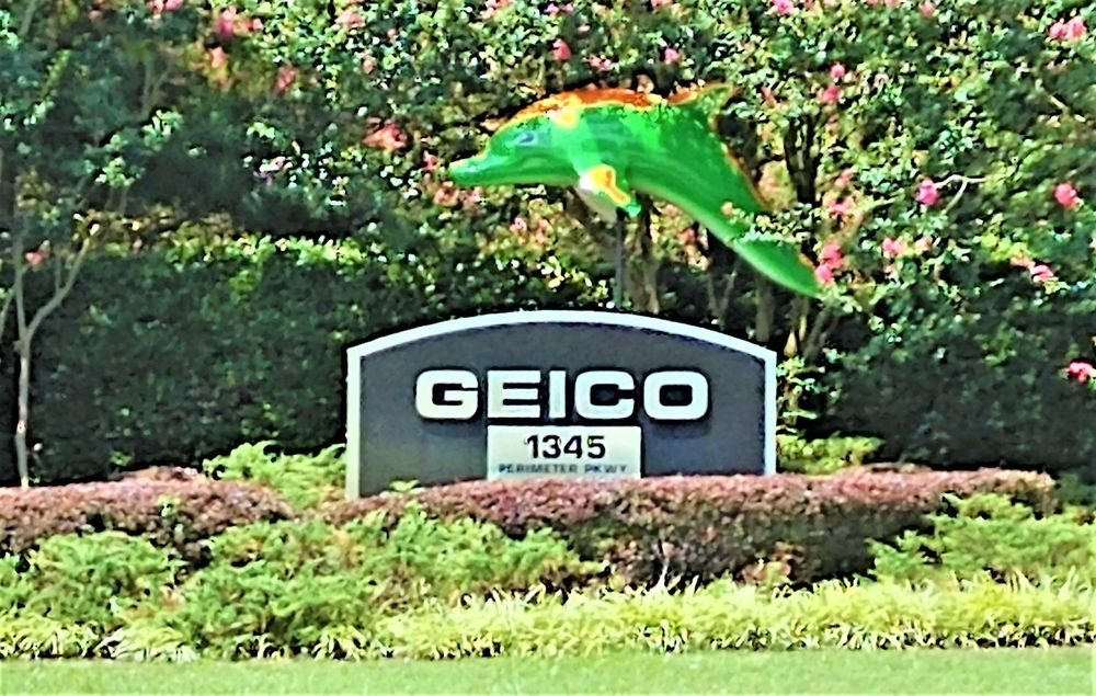 Photo of GEICO Regional Office - Virginia Beach, VA, United States. This is the GEICO sign and GEICO Dolphin as you enter the GEICO property. Photo taken July 19, 2018.