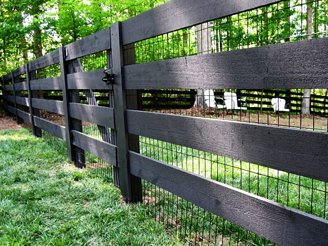 Rustic 4 Board Fence Stained Black With Black Vinyl