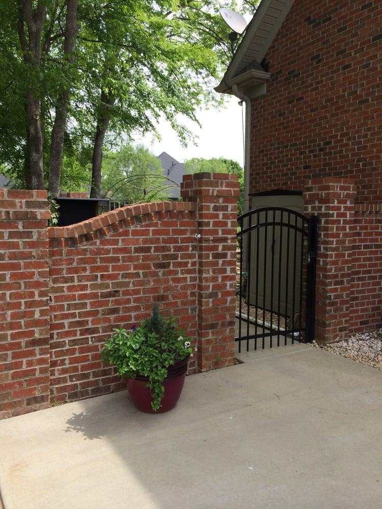 Decorative Brick Wall W Aluminum Arched Gate Yelp