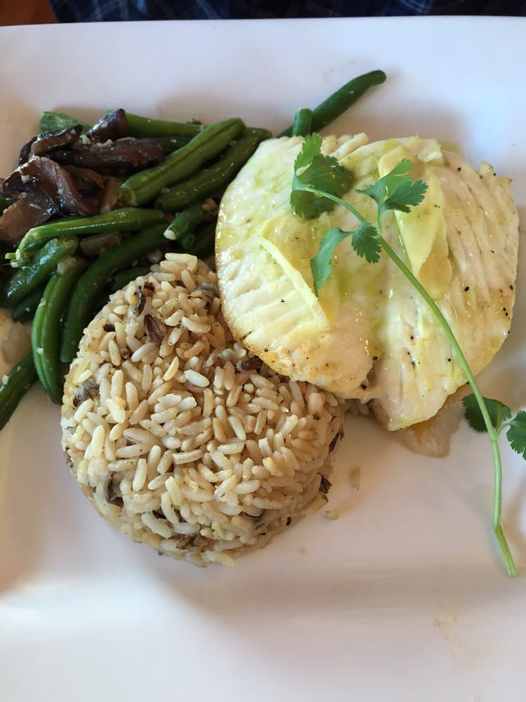 Halibut with rice pilaf for Phil s fish market eatery