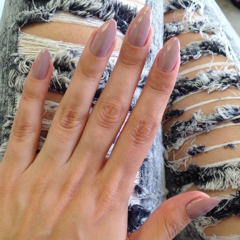 Stiletto shape on my natural nails, color LadyLike by Essie. - Yelp