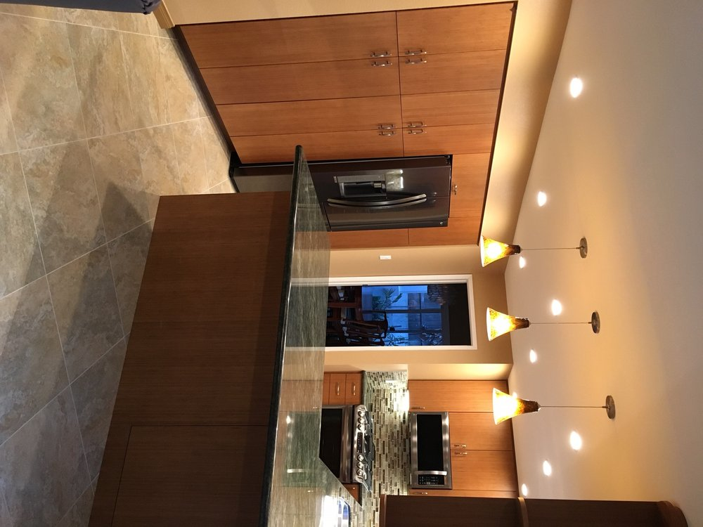 Tropical green granite with custom bamboo cabinets - Yelp
