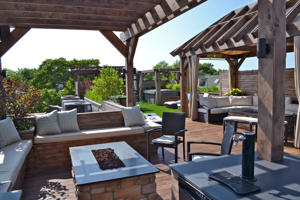 Roof deck with pergola fire pit kegerator and seating for Garden decking seating areas