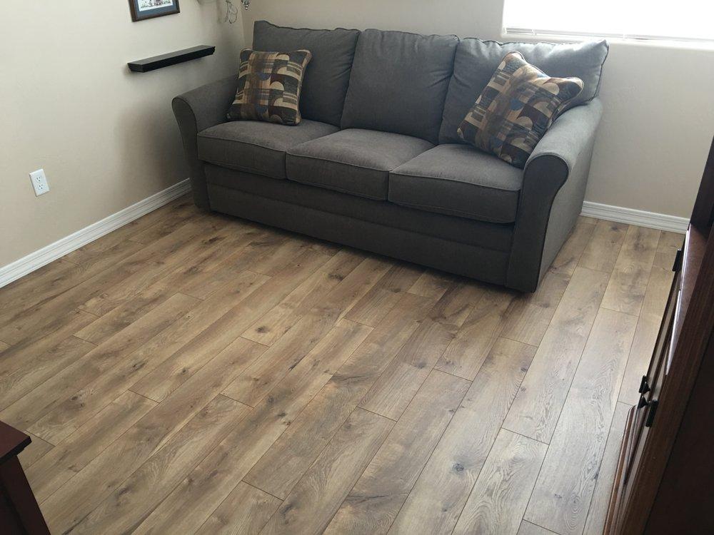 Complete Flooring Installed Century Oak Laminate In A Guest Bedroom